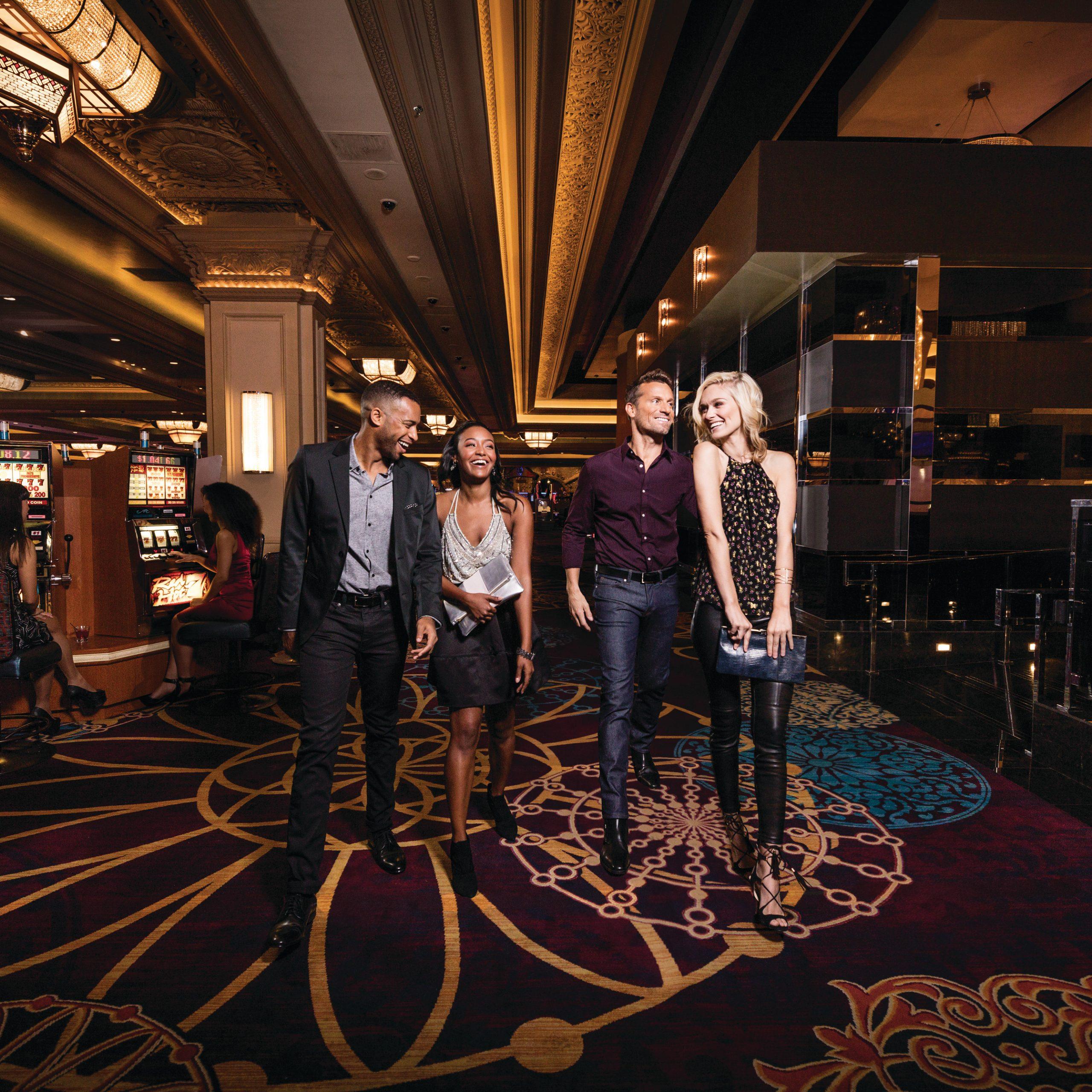 People walking through a casino